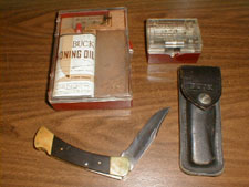 Buck knife with accessories